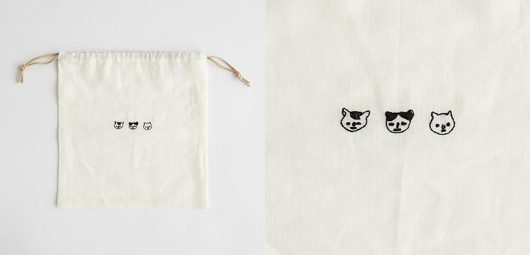 四角形のハギレで作ったPOOLの巾着には猫の刺繍